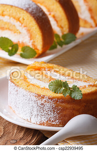 Slice of sweet carrot rolls on a plate - csp22939495