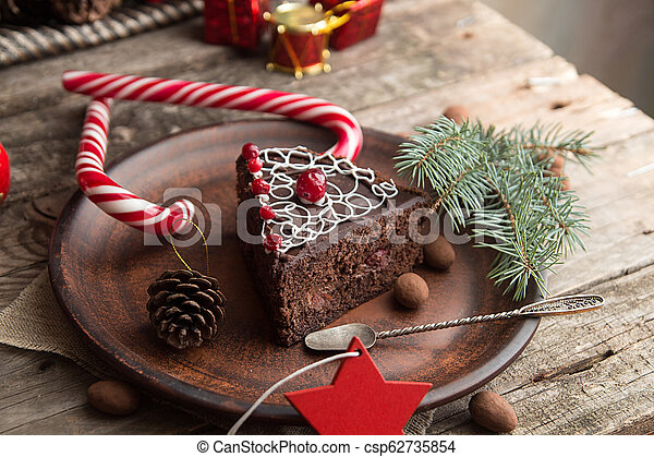 Slice of sweet chocolate cake for Christmas Eve. - csp62735854