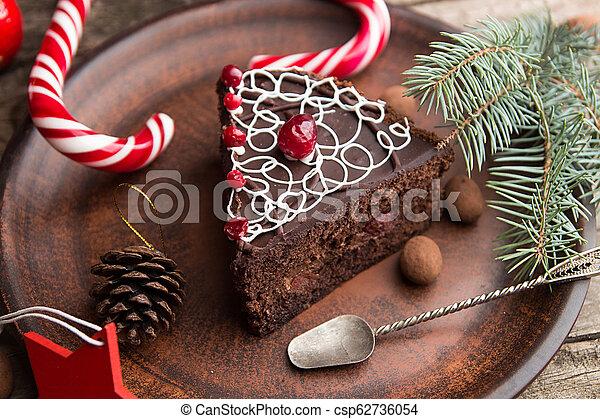 Slice of sweet chocolate cake for Christmas Eve. - csp62736054