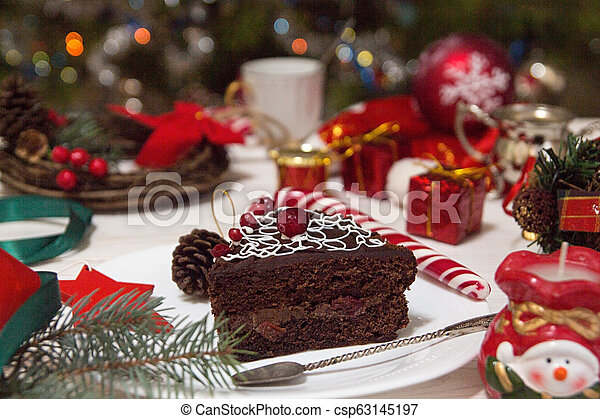 Slice of sweet chocolate cake for Christmas Eve. - csp63145197