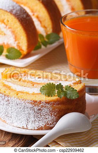 Slice of sweet pumpkin roll on a plate. Vertical - csp22939462