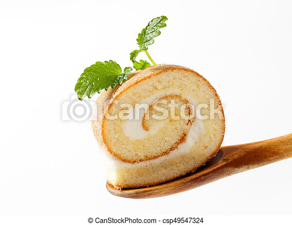 Slice of sweet roll on a wooden spoon - csp49547324