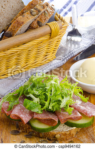 slice sunflower seed bread with salami - csp9494162