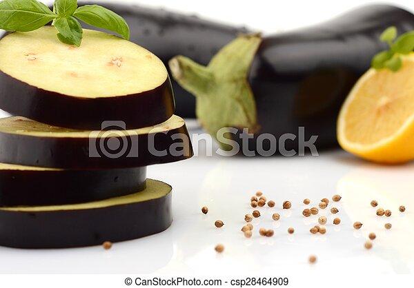 Sliced aubergine, eggplant with basil leaves and coriander seeds, lemon - csp28464909