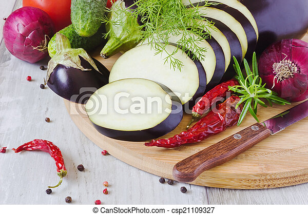 sliced eggplant and other vegetables - csp21109327