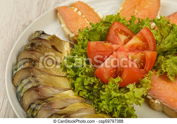 Sliced herring on a plate with herbs. - csp59797388