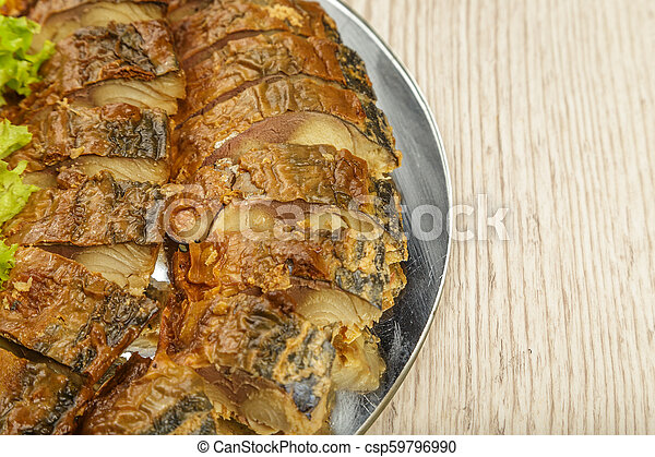 Sliced herring on a plate with herbs. - csp59796990