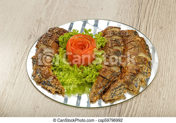 Sliced herring on a plate with herbs. - csp59796992