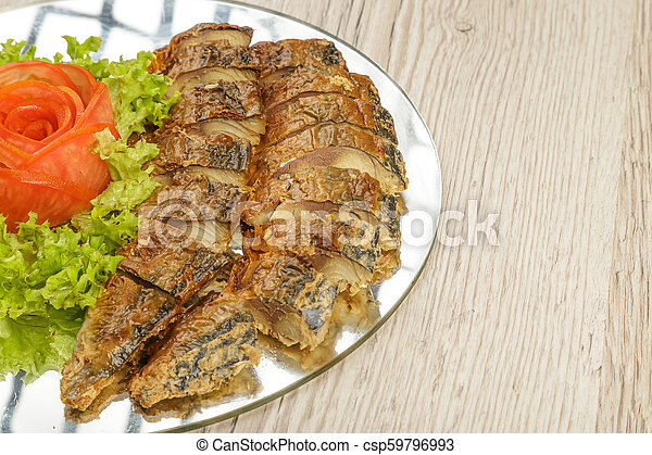 Sliced herring on a plate with herbs. - csp59796993