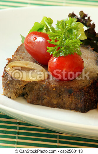 sliced meat loaf with organic parsley on a plate - csp2560113
