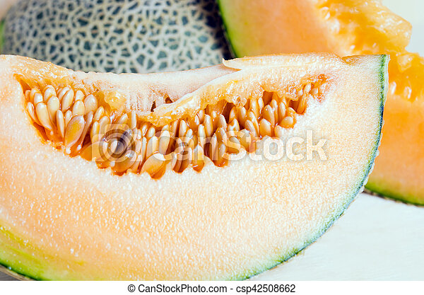 Sliced Melon With Seed On Wooden Board Other Names Are Cantelope