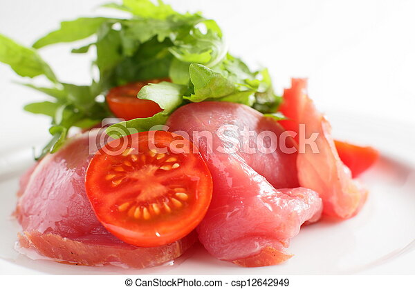 sliced peaces of meat with tomato - csp12642949