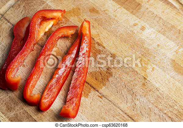 Sliced red pepper on a wooden Board. - csp63620168