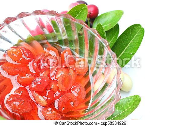 Sliced welded carissa carandas fruits on white background - csp58384926