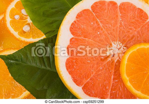 Slices of a lemon, orange, grapefruit - csp59251299