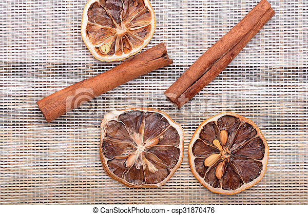 Slices of fresh dried lemon, orange and spices for cooking or baking - csp31870476