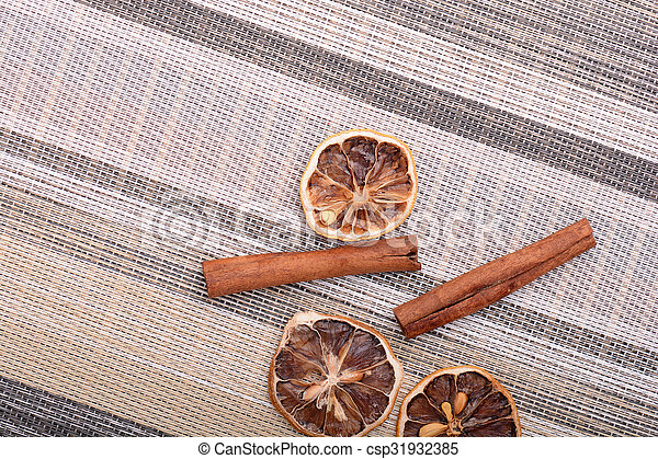 Slices of fresh dried lemon, orange and spices for cooking or baking - csp31932385