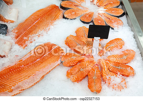 Slices of fresh raw salmon in ice ready to sale at the market - csp22327153