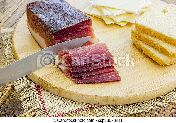 Slices of Italian Speck - csp33078211