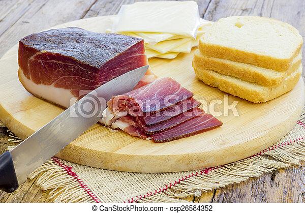 Slices of Italian Speck - csp26584352