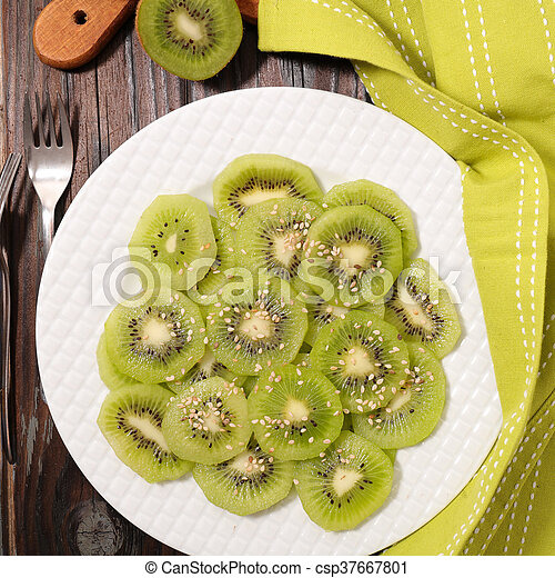 slices of kiwi for breakfast - csp37667801