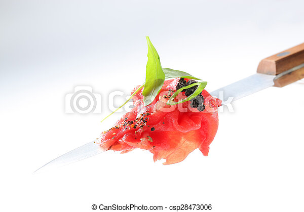 Slices of raw beef on knife - csp28473006