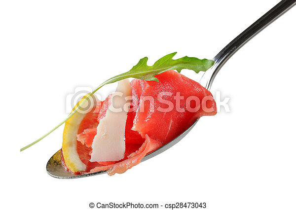 Slices of raw beef on spoon - csp28473043