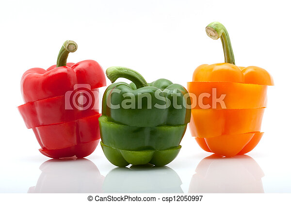 slices of red, green and orange pepper isolated on white background - csp12050997