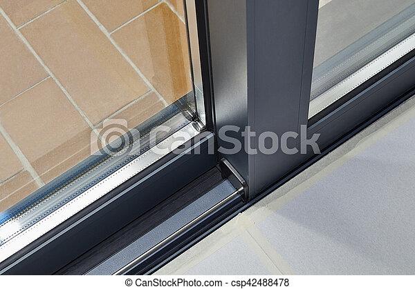 Sliding glass door detail and rail - csp42488478