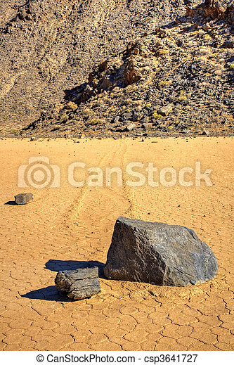 Sliding Stones On Dry Lakebed - csp3641727