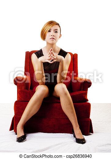 Slim Asian American Woman Sitting In Chair - csp26836940