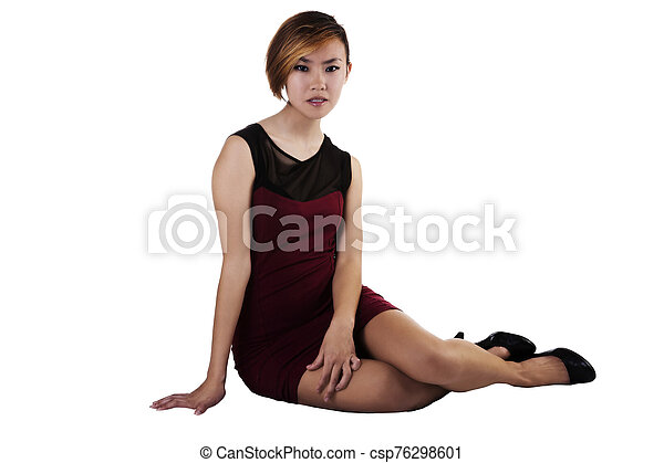 Slim Asian American Woman Sitting Red And Black Dress - csp76298601