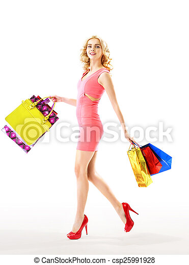 Slim blond woman holding a bunch of paper bags - csp25991928