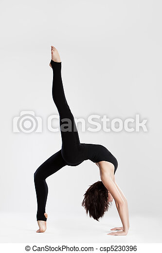 Slim dancer in yoga pose bending backwards - csp5230396