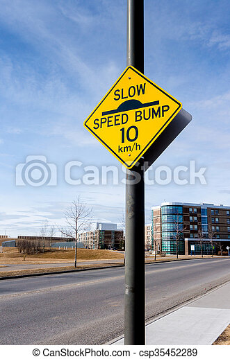 Slow Speed Bump Road Sign on Residential Street - csp35452289