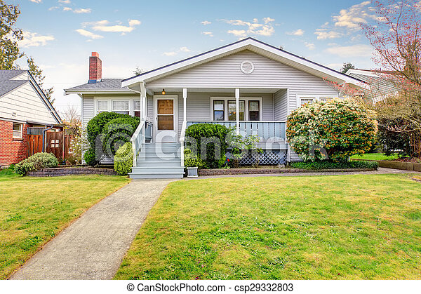 Small American home with light exterior and white trim. - csp29332803