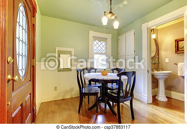 Small and cozy dining room with black wood table chair set... stock ...