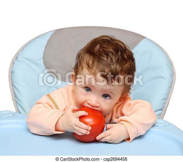 small baby biting tomato - csp2694458