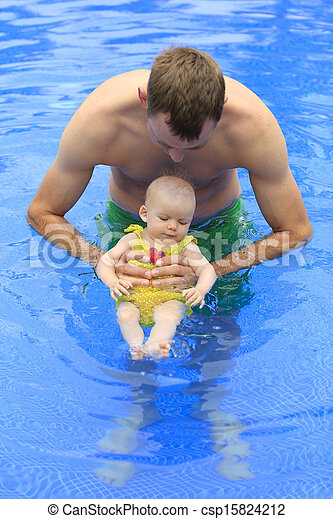 Small baby girl is swimming in the pool with daddy for the first time three months old baby 3 month old baby swimming pool