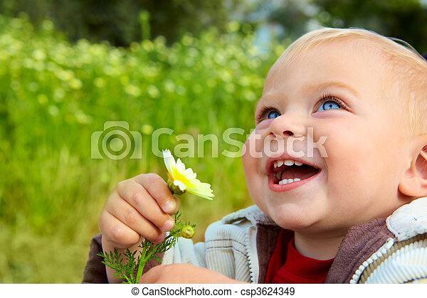 small baby laughing with daisy - csp3624349