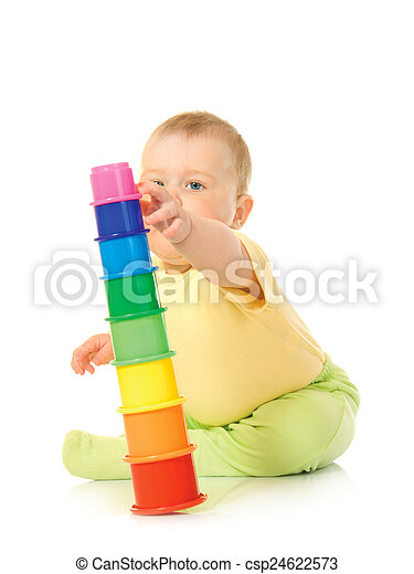 Small baby with toy pyramid  - csp24622573