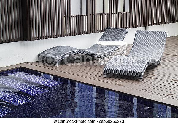 Small backyard with small swimming pool spa - csp60256273