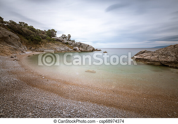 Small bay of Sveti Blaz on a cloudy day in spring - csp68974374