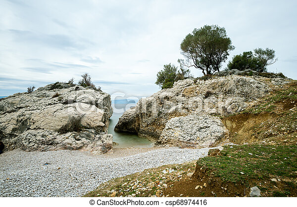 Small bay of Sveti Blaz on a cloudy day in spring - csp68974416