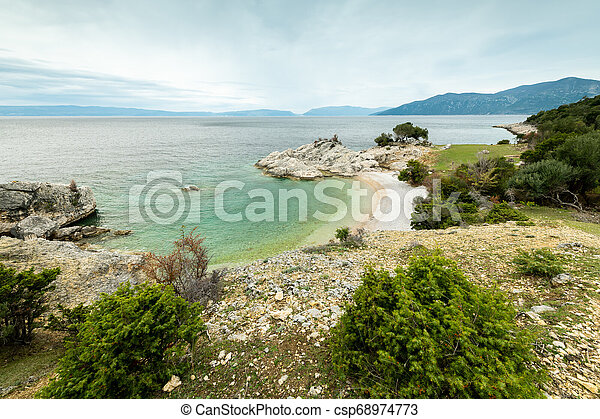 Small bay of Sveti Blaz on a cloudy day in spring - csp68974773