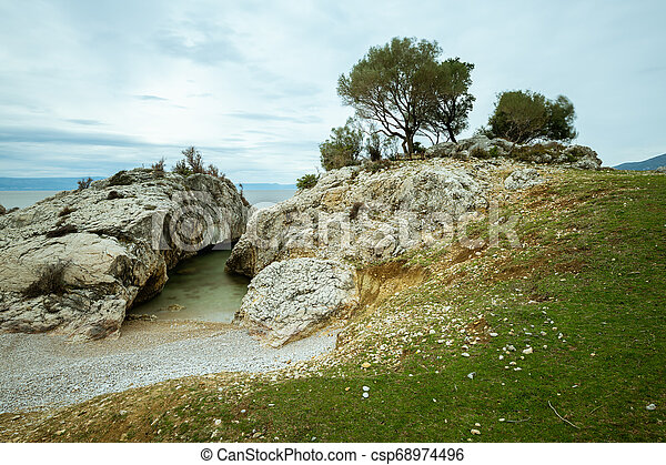 Small bay of Sveti Blaz on a cloudy day in spring - csp68974496