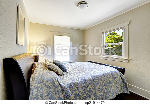 Small bedroom with modern black bed