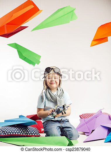 Small boy playing toy plane - csp23879040
