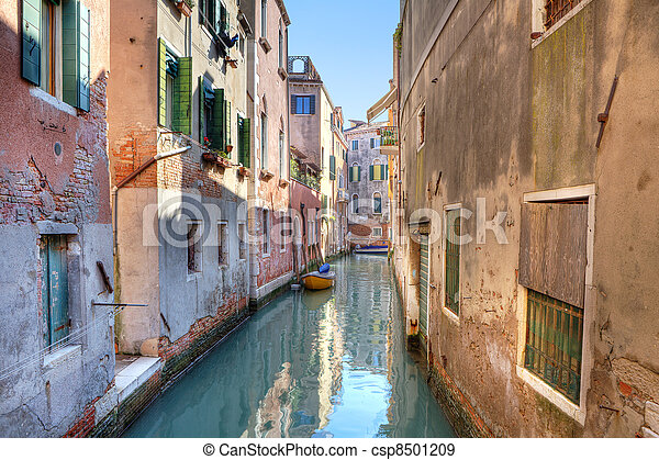Small canal among houses. Venice, Italy. - csp8501209