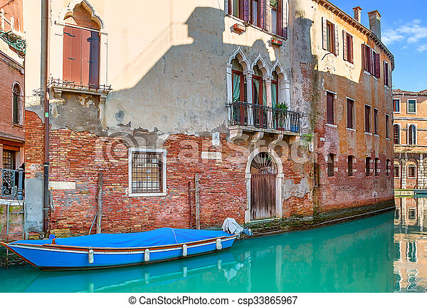 Small canal in Venice, Italy. - csp33865967